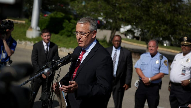 FBI Special Agent in Charge David Gelios talks to the press at Bishop International Airport in Flint after a police officer was stabbed earlier in the day on Wednesday, June 21, 2017.
