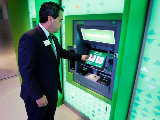 February 22, 2015 - David May, president of Regions Bank for the West Tennessee Area, demonstrates how the Video Teller ATM works at the bank's new downtown branch which opens on Monday.