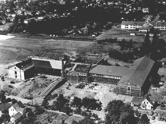 Salem High School is seen during construction in 1935-36. Parrish Middle School is in the background.