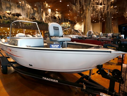 A V bottom aluminum bass boat at Bass Pro Shops on