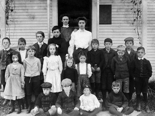 Children in front of rural schoolhouse in Addison County, c. 1895.