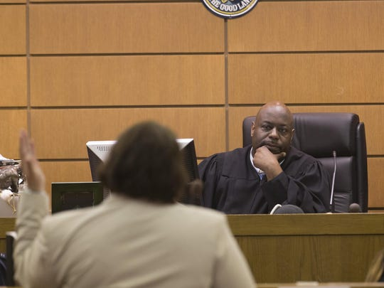 Judge Derek Mosley presides in his courtroom at Milwaukee Municipal Court in Milwaukee.