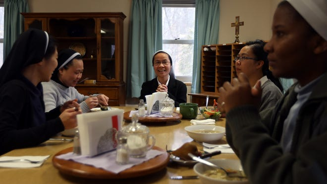 Students at the Assumption College for Sisters eat lunch prepared by Sister Maria Cecilia Landis, who cooks for over thirty of the students on the campus of Morris Catholic in Denville. She recently took a four-week class at Atlantic Health SystemÕs Chambers Center for Well Being and is making new and healthier meals for the students. February 23, 2016. Denville, N.J.