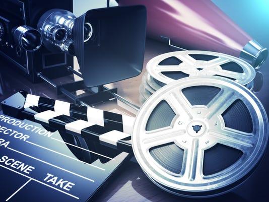 Video, movie, cinema vintage concept. Retro camera, reels and cl