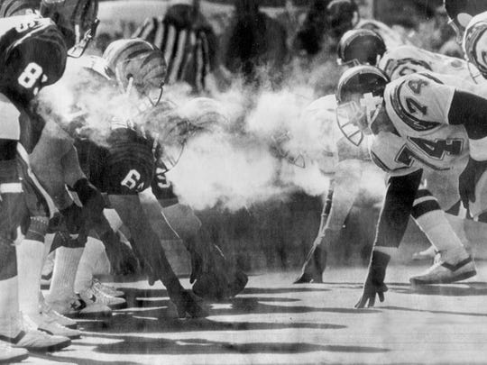 """Sub-zero temperatures were not enough to stop the Bengals, left, lining up against the San Diego Chargers during the AFC championship game on Jan. 10, 1982, in what was dubbed """"The Freezer Bowl"""" at Riverfront Stadium."""