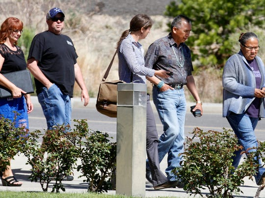 San Juan Chapter President Rick Nez, second from right, walks out of the Farmington Municipal Court building on Wednesday, May 4, 2016 after an initial court hearing for Tom Begaye, who has been accused of abducting and killing 11-year-old Ashlynne Mike. He faces murder and kidnapping charges.