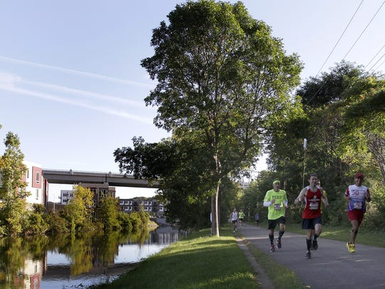 Marathon runners make their way along the Newberry Trail in Appleton in 2015. Outagamie County is pursuing opportunities to connect trails along the Fox River from Appleton to Kaukauna.