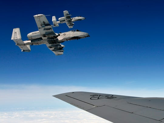 Two A-10 Thunderbolt II Warthogs return to Selfridge after in-flight refueling.