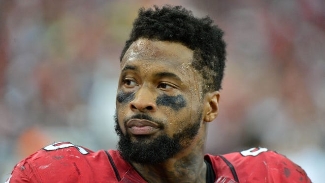 Arizona Cardinals defensive end Darnell Dockett (90) looks on during the second half against the Atlanta Falcons at University of Phoenix Stadium.