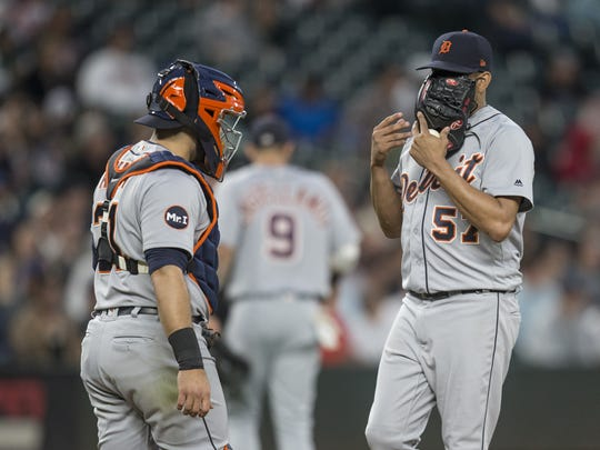 Tigers catcher Alex Avila and relief pitcher Francisco