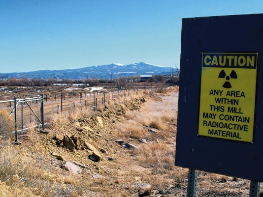 A warning sign at the old Kerr-McGee uranium mill site is shown on open land in the foreground with Mount Taylor in the background on Dec. 20, 2007, near Grants.