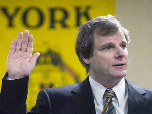Michael Helfrich, sworn in on the York City Council Jan. 3, may retain his position, a judge ruled Wednesday.