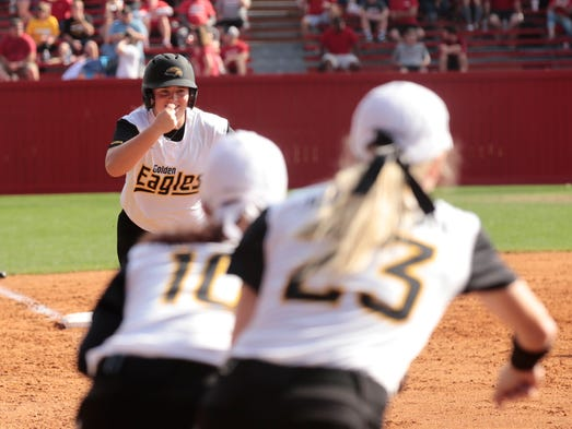 Southern Miss' Lauren Holifield rounds third base after