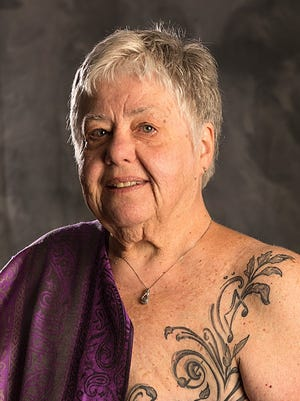Patricia Eby of Fond du Lac shows the tattoo she got to cover scars from a 2016 mastectomy.