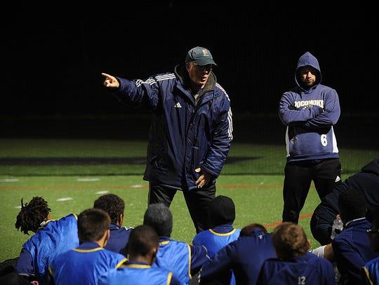 Pocomoke boys soccer head coach Alan Byrd talks to