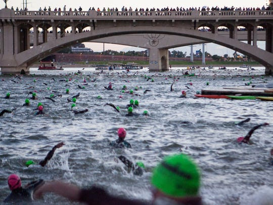 Arizona Ironman competitors begin their race with a