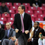 Maryland's Mark Turgeon, right, talk to his players during action this season.
