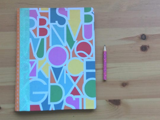 Personalize your Composition notebooks with patterned scrapbook paper.
