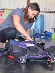 Bree Eggleston of Skydive Allegan packs the parachutes.