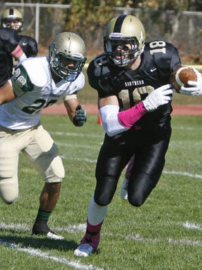 Southern's Mike Gesicki, right, evades Brick Memorial's Mike Basile at Southern Regional High School in Manahawkin Oct. 26, 2013.