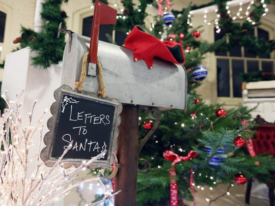 A place to drop off letters to Santa Claus is set up during Magic at the Mill Saturday, Dec. 19, 2015, in Salem, Ore.