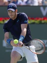 Andy Murray hits a shot during his loss to Novak Djokovic