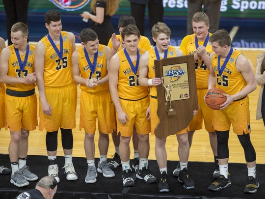 The Morristown High School players celebrate with their trophy after winning the IHSAA Boys' Basketball Class A State Finals game at Bankers Life Fieldhouse, Saturday, March 24, 2018. Morristown won 89-60.