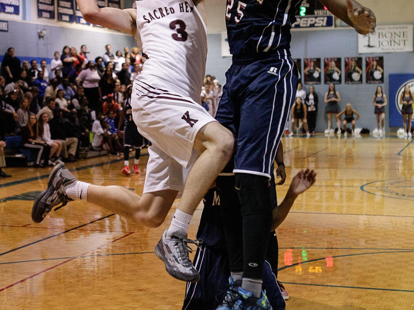 Sacred Heart's Wes Ragsdale goes up for a layup Friday against Madison.