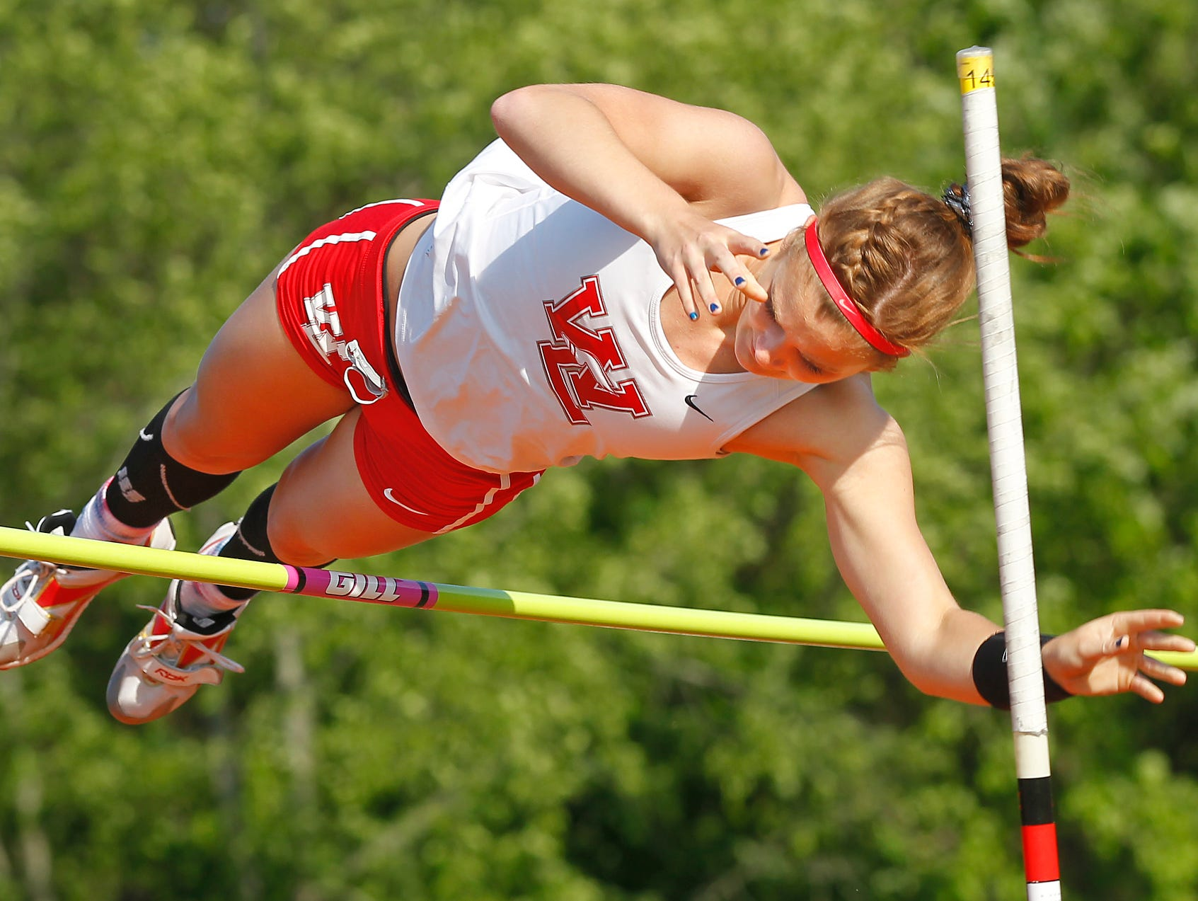 West Lafayette's Maria Siciliano clears 11 feet in the pole vault on her way to victory Tuesday in the event at the girls track sectional hosted by Harrison.