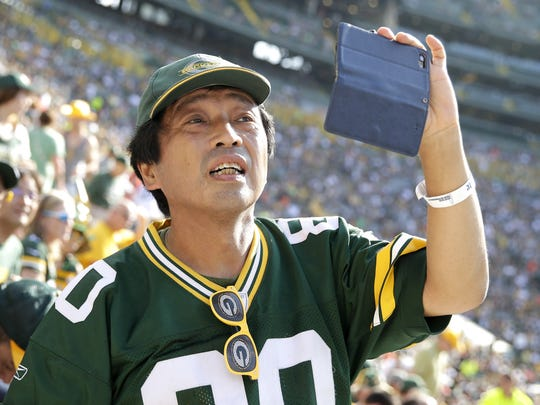 Japanese Green Bay Packers fan Takashi Kawarazaki takes a photo inside Lambeau Field before the start of the Sept. 24, 2017 game against the Cincinnati Bengals. He, along with 23 other people from Japan, traveled to Wisconsin for the game. Sarah Kloepping/USA TODAY NETWORK-Wisconsin