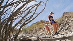 Emily Crafton (right) and Kimberly Ander hike down the summit trail on Piestewa Peak on Wednesday afternoon, May 31, 2017 in Phoenix.