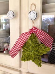 Instead of placing all of your ornaments on the tree, save a few back to hang in unexpected places.