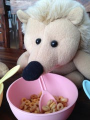 Balthazar the Pink enjoys some cereal.