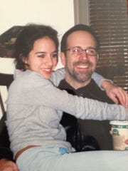 A photo of Emily Holt and her father William. He died
