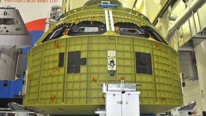 Kennedy Space Center teams have begun assembling the Orion exploration capsule. The capsule's 2,700-pound crew cabin was delivered Monday from NASA's Michoud Assembly Facility near New Orleans and was on display for the media in the Armstrong Operations and Checkout Building.