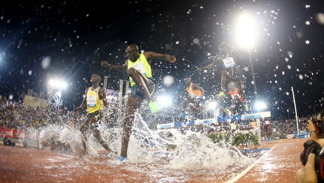 FILE - This is a Friday May 9, 2014  file photo of athletes as they compete in the men's 3,000m steeplechase at the IAAF Diamond League in the Qatari capital Doha. Doha ere chosen Tuesday Nov. 18, 2014 to host the 2019 athletics world championships. The Qatari capital beat  bids from Eugene, Oregon, and Barcelona in a secret vote Tuesday by members of the IAAF council.  (AP Photo/Osama Faisal)