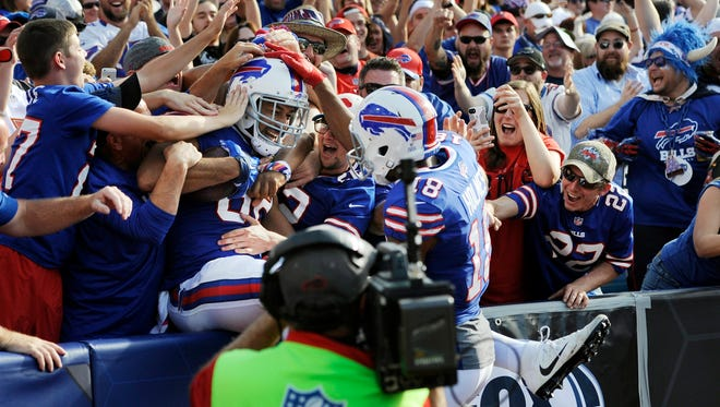 Buffalo Bills tight end Logan Thomas celebrates his touchdown with fans during the second half of an NFL football game against the Tampa Bay Buccaneers, Sunday, Oct. 22, 2017, in Orchard Park, N.Y. (AP Photo/Adrian Kraus)