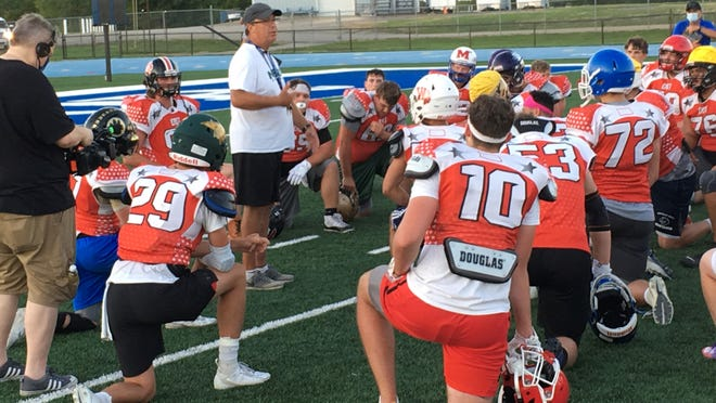East head coach Steve Buhler talks to his team after a practice for Saturday night's Kansas Shrine Bowl at Hummer Sports Park.