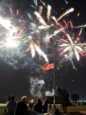 Fireworks explode over the W.H. Lyon Fairgrounds on Saturday.