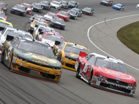 Austin Dillon, driver of the #3 Bass Pro Shops/Cabela's Chevrolet, and Ryan Reed, driver of the #16 Drive Down A1C Lilly Diabetes Ford, lead the field to a restart during the NASCAR Xfinity Series LTi Printing 250 at Michigan International Speedway on June 9, 2018 in Brooklyn, Michigan.