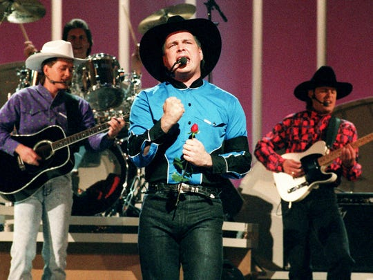 "Garth Brooks performs ""Shameless"" during the 25th annual CMA Awards show at the Grand Ole Opry House Oct. 2, 1991."