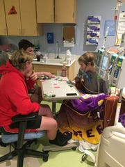 Bryan Day plays cards with some friends in his hospital