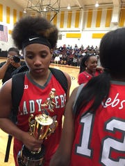"North Caddo""s Destiny Rice carries her MVP trophy after"