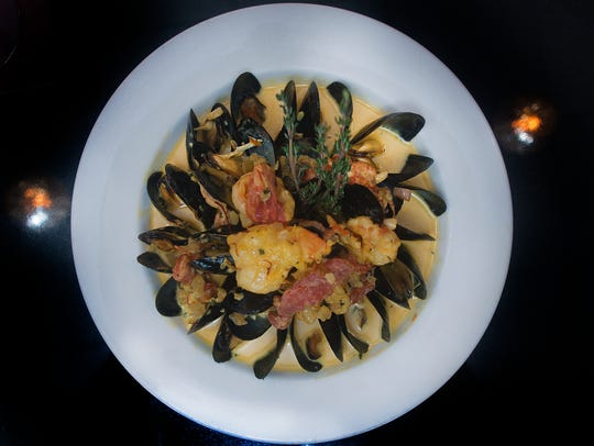 A Saffron Mussels dish is shown at Giumarello's Restaurant & G Bar.