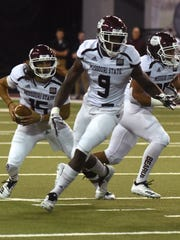Missouri State's Peyton Huslig (15) runs the ball during