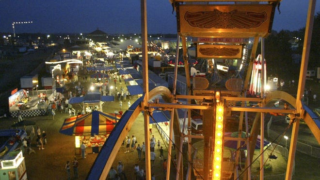 The lights of the midway illuminate the sky over the Central Wisconsin State Fair in this file photo.
