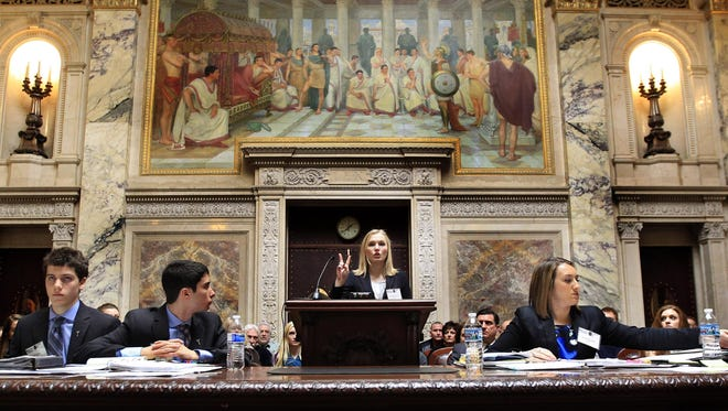 The Xavier Mock Trial team's Elizabeth Totzke presents opening arguments during the Wisconsin High School Mock Trial tournament championship in the state Supreme Court chambers in Madison in March. The Xavier team defeated Shorewood to take the state title and move on to nationals in North Carolina.