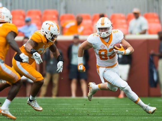 Tight end Ethan Wolf (82) runs down the field with the ball during the Orange & White game in Neyland Stadium on Saturday, April 22, 2017.