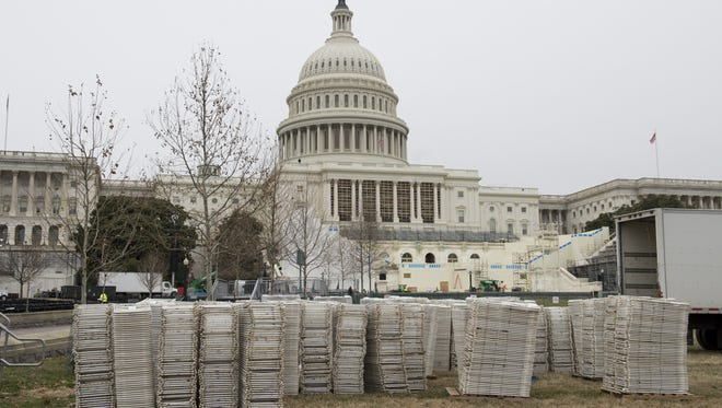 Folding chairs await setup as preparations continue for the Presidential Inauguration for incoming US President Donald Trump at the US Capitol. The Nashua Telegraph takes Congress to task over its budget resolution.
