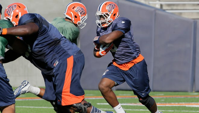 Treyvon Hughes (taking hand off) will the third UTEP running back that will see plenty of action this coming Saturday night at NMSU, along with Darrin and brother Jeremiah Laufasa. The three will share ball carrying duties after starting running back Aaron Jones was lost for the season with ligament damage to his ankle.